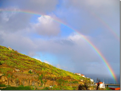 madeira news blog 0912 sheila A rainbow emerges from the clouds to slip into the sea off Santa Cruz